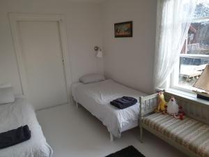 Säng eller sängar i ett rum på Myskje Gård Gästgiveri