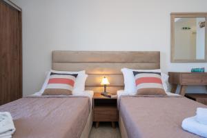 Ένα ή περισσότερα κρεβάτια σε δωμάτιο στο Dimitris Studios