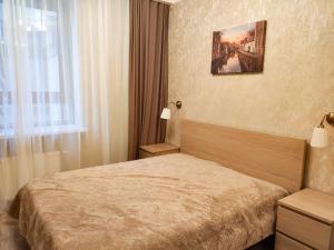 Кровать или кровати в номере D&M Graf Orlov