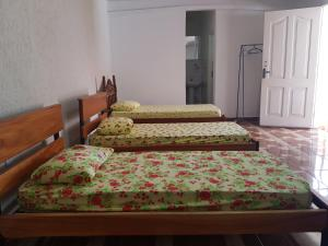 A bed or beds in a room at SUITE FAMILIAR/ 5 PESSOAS