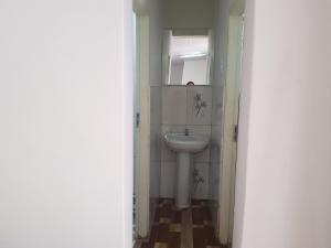A bathroom at SUITE FAMILIAR/ 5 PESSOAS