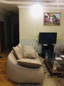 Uma área de estar em Shangrila Ceylon Hostal