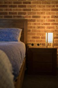 A bed or beds in a room at Mudgee Apartments on Church Street