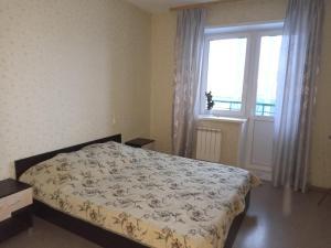 Кровать или кровати в номере Respublikanskaya 6