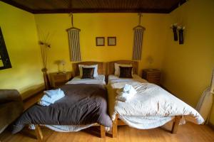 A bed or beds in a room at Casa do Manego