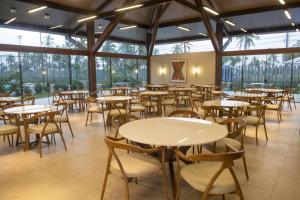 A restaurant or other place to eat at Novo Bangalô no Malawi Beach House com Premium Service