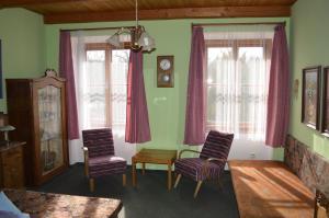 Posezení v ubytování Penzion Medvedi Paseka