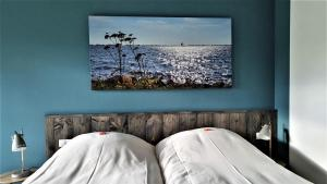 A bed or beds in a room at HOTEL2Heerenveen