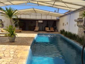 The swimming pool at or near Adriana Beach Pousada