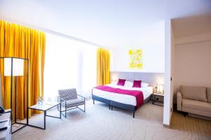 Łóżko lub łóżka w pokoju w obiekcie Arche Hotel Krakowska