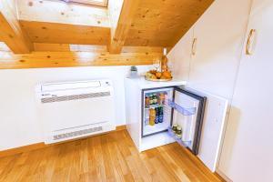 A kitchen or kitchenette at New Lux Villa Merissima