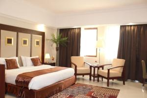 Cama ou camas em um quarto em Dolphin Beach Resort