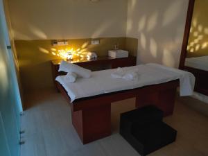 Cama o camas de una habitación en Holy River Hotel