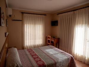 A bed or beds in a room at Hostal Durá