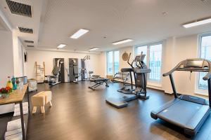 The fitness center and/or fitness facilities at LOGINN Hotel Leipzig by ACHAT
