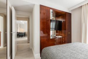 Cama o camas de una habitación en Suites Center Barcelona