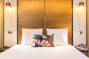 A bed or beds in a room at Mercure Luxembourg Off Kirchberg