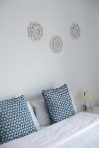 Łóżko lub łóżka w pokoju w obiekcie Corralejo Center, CoLiving&CoWorking