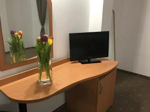 A television and/or entertainment center at Hotel Vandia