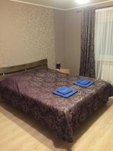 Кровать или кровати в номере Гостевой Дом на Ильинской