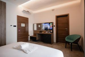 A television and/or entertainment center at Pebbles Resort
