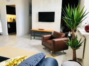 Telewizja i/lub zestaw kina domowego w obiekcie Mila Apartments Szczecin