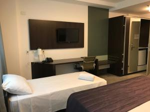 A bed or beds in a room at Blue Tree Premium Alphaville