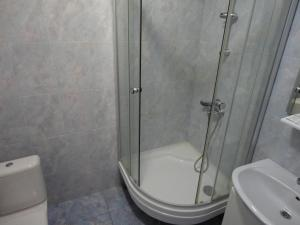 Ванная комната в Гостиничный Компелкс Ельцовский