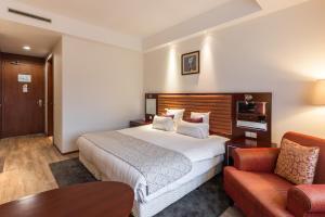 Een bed of bedden in een kamer bij Shanghai Hotel Holland