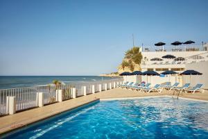 The swimming pool at or near Holiday Inn Algarve - Armação de Pêra, an IHG Hotel