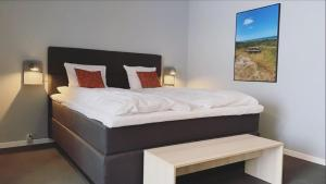 A bed or beds in a room at Skaga Hotel