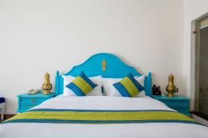 A bed or beds in a room at Aagantuk Resort