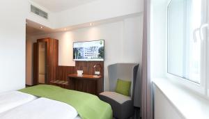 A television and/or entertainment centre at numberOne Hotel
