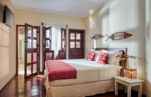 Cama ou camas em um quarto em Pousada Surfing Jeri