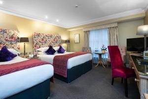 Un ou plusieurs lits dans un hébergement de l'établissement Brooks Hotel