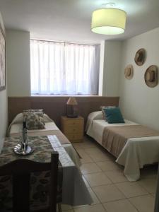 A bed or beds in a room at Acogedor monoambiente , en el centro de mendoza .