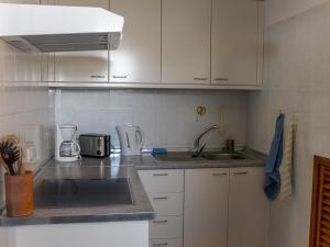 Una cocina o zona de cocina en Apartamentos Finca La Cruz