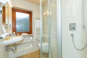 Ein Badezimmer in der Unterkunft Gästehaus Flora