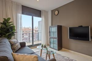 A television and/or entertainment center at SLEEP Fira by STAY
