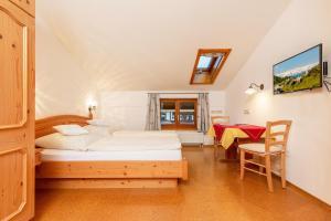 Ein Bett oder Betten in einem Zimmer der Unterkunft Gästehaus Flora