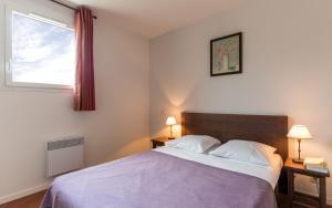 Un ou plusieurs lits dans un hébergement de l'établissement Le Domaine des Cazelles by Ateya Vacances