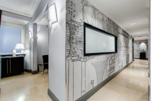 A television and/or entertainment center at Residenza A The Small Art Hotel
