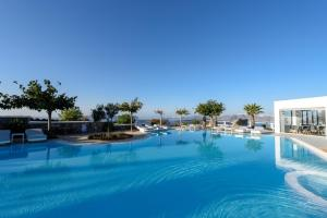 The swimming pool at or near Maison Des Lys - Luxury Suites