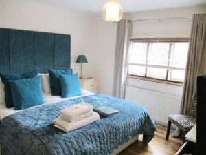 A bed or beds in a room at Copper Beech House