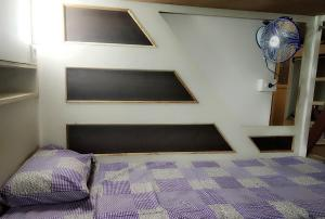 A bed or beds in a room at Aaramgruh Hotel Dormitory