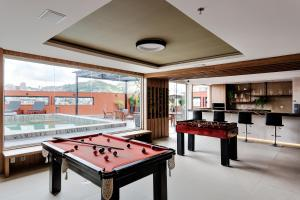 A pool table at Victory Business Hotel