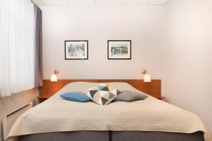 A bed or beds in a room at Aalesund Airport Hotel