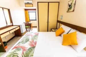 Cama ou camas em um quarto em Hotel Verdemar