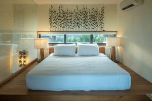 A bed or beds in a room at Bangkok Tree House