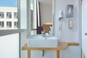 A bathroom at Best Western Hotel Berlin Mitte